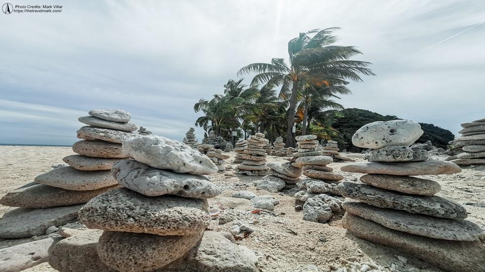 Stone Balancing at Cabugao Gamay Island - Gigantes Island