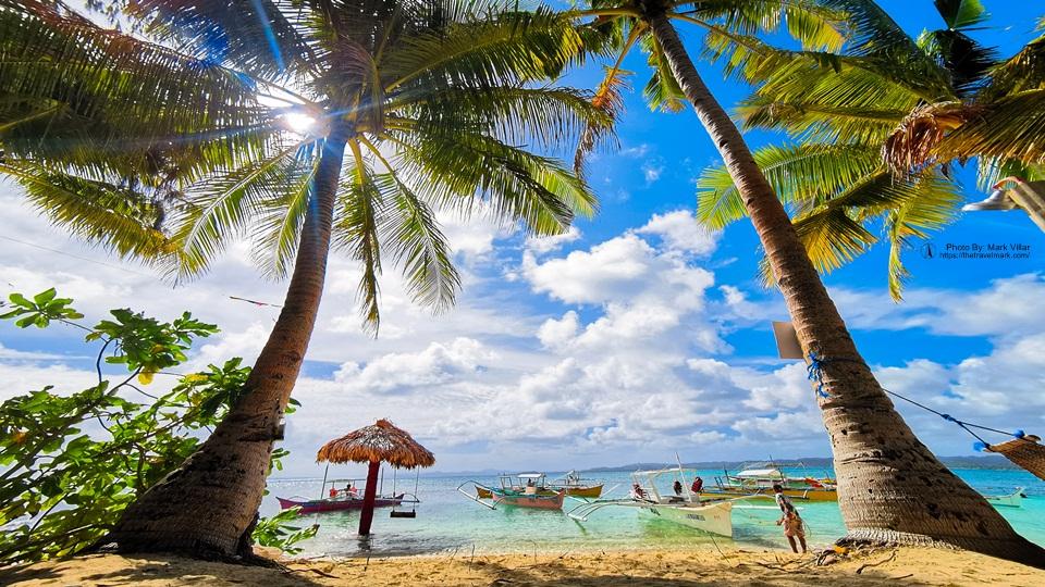 Boat Docked In Guyam Island Siargao - The Travel Mark