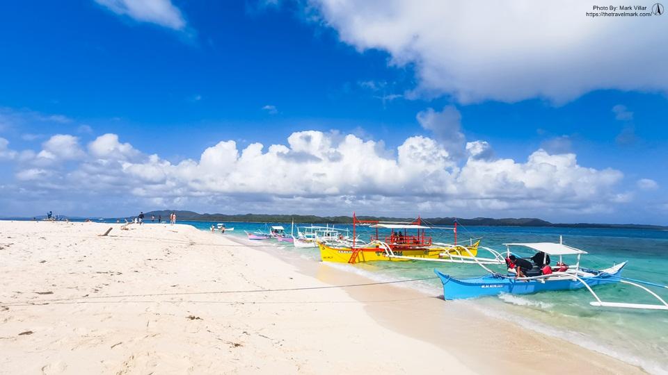 Boat Docked In Naked Island Siargao - The Travel Mark